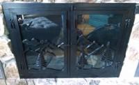 mountain motif fireplace doors: BradGreenwoodDesigns.com